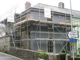 Erected scaffolding around a small building
